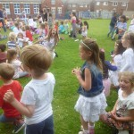 KS1 having fun dancing on the field.